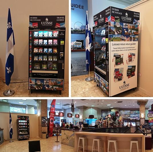 Une machine distributrice de guides de voyage Ulysse accessible au Centre Infotouriste de Montréal